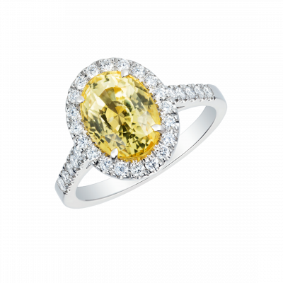 Regal Ring set with an oval cut yellow sapphire and diamonds