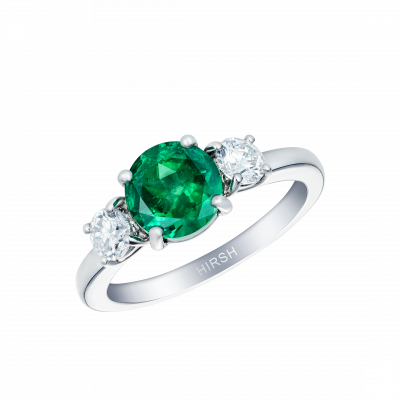 Trilogy Ring set with an Emerald