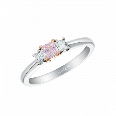 Trilogy ring set with a purplish pink diamond